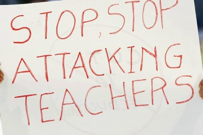 120306031206-teacher-protest-attack-story-top.jpg