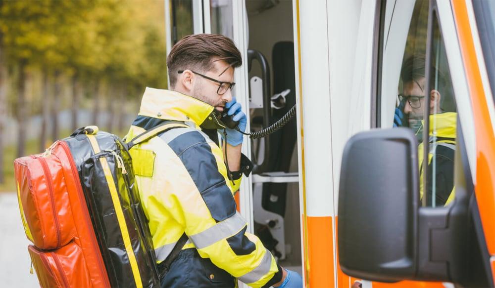 ambulance worker talking on radio