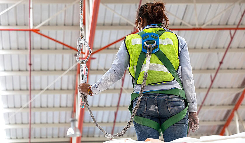 female worker in a safety harness
