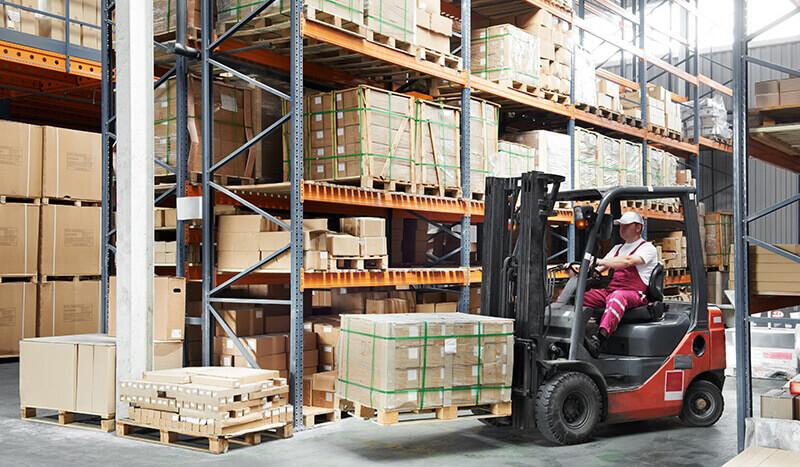 warehouse worker using a pallet lift truck